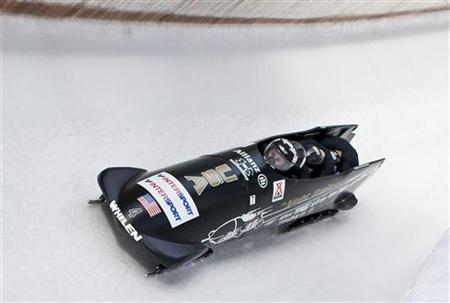 US team members Steven Holcomb (L-R), Justin Olsen, Steve Mesler and Curtis Tomasevicz speed down the track during the Bobsleigh and Skeleton World Cup competition in Igls/Innsbruck January 24, 2010. REUTERS/Miro Kuzmanovic