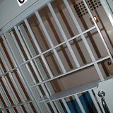 A modern cell in Brecksville Police Department, Brecksville, Ohio By Andrew Bardwell from Cleveland, Ohio, USA (Jail Cell) [CC-BY-SA-2.0 (http://creativecommons.org/licenses/by-sa/2.0)], via Wikimedia Commons