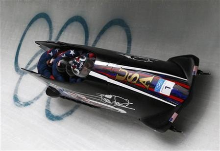 Pilot Steven Holcomb, Justin Olsen, Steve Mesler and Curtis Tomasevicz of team USA 1 speed down the track during heat 3 of the four-man bobsleigh competition at the Vancouver 2010 Winter Olympics in Whistler, British Columbia, February 27, 2010. REUTERS/Pawel Kopczynski