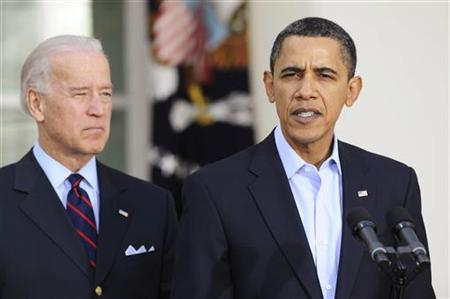 President Barack Obama (R), standing with Vice President Joe Biden, gives remarks on the parliamentary election in Iraq, in the Rose Garden at the White House in Washington, March 7, 2010. REUTERS/Jonathan Ernst