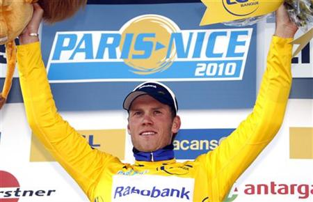 Rabobank's team rider Lars Boom of Netherlands celebrates on the podium of the second stage of Paris-Nice cycling race between Contres and Limoges March 9, 2010. Boom retains his yellow leader jersey and William Bonnet of France won the stage. REUTERS/Eric Gaillard