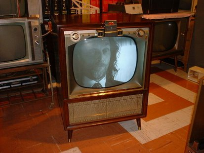 "This is a 1957 Zenith TV with ""Space Command 200"" remote control, the first model by Zenith with the new wireless remote control. By Drh4683 (D. Harland) [Public domain], via Wikimedia Commons"