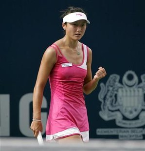 Yan Zi of China reacts after scoring point during her match against Ayumi Morita of Japan at the WTA Malaysian Open 2010 Tennis Championship in Kuala Lumpur February 24, 2010. REUTERS/Bazuki Muhammad