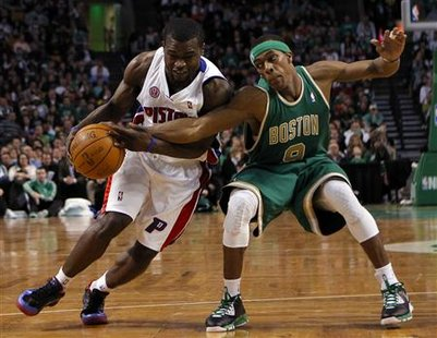 Boston Celtics guard Rajon Rondo (R) reaches in to knock the ball away from Detroit Pistons guard Will Bynum in the second half of their NBA basketball game in Boston, Massachusetts March 15, 2010. REUTERS/Brian Snyder