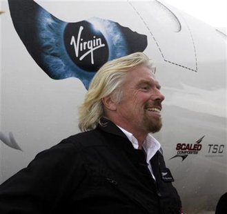 Richard Branson stands beside Virgin Mother Ship Eve, White Knight Two, at Wittman Field, site of the Experimental Aircraft Association Convention in Oshkosh, Wisconsin July 27, 2009. REUTERS/Allen Fredrickson