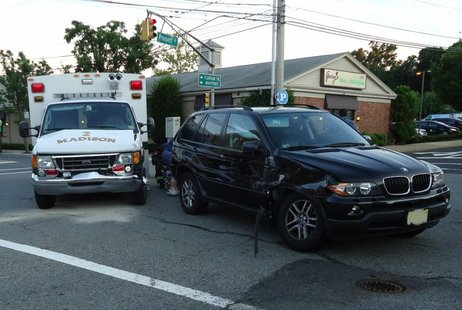 The ambulance (left) was taking crash victims to the hospital when it was subsequently involved in this crash (shown). In Madison, New Jersey. By Tomwsulcer (Own work) [CC0], via Wikimedia Commons