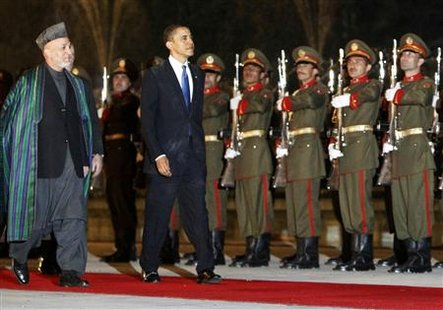U.S. President Barack Obama inspects a guard of honor with Afghan President Hamid Karzai at the Presidential Palace in Kabul, March 28, 2010. REUTERS/Jim Young