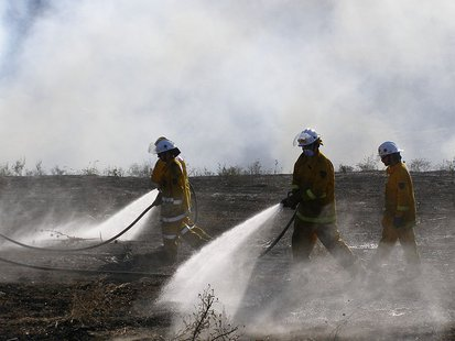 Firefighters put water on a small grass fire. Emmanuellives at the English language Wikipedia [GFDL (http://www.gnu.org/copyleft/fdl.html), CC-BY-SA-3.0 (http://creativecommons.org/licenses/by-sa/3.0/) or GFDL (http://www.gnu.org/copyleft/fdl.html)], from Wikimedia Commons