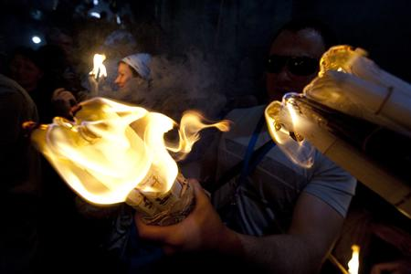 Worshippers hold candles as they take part in the Christian Orthodox Holy Fire ceremony at the Church of the Holy Sepulchre in Jerusalem's Old city April 3, 2010. REUTERS/Ammar Awad