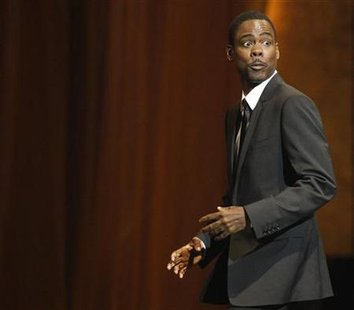 Actor Chris Rock walks on stage to accept the award for Outstanding Documentary at the 41st Annual NAACP Image Awards at the Shrine auditorium in Los Angeles February 26, 2010. REUTERS/Mario Anzuoni