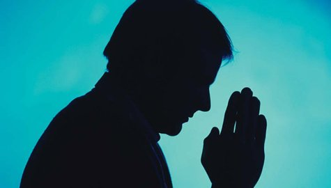 Image of a man praying.
