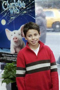 "Actor Jake T. Austin arrives for the premiere of the film ""Charlotte's Web"" in New York December 3, 2006. REUTERS/Keith Bedford"
