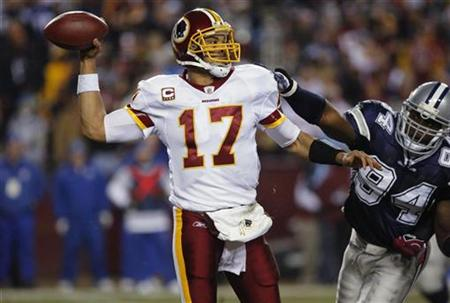 Washington Redskins quarterback Jason Campbell (17) throws under pressure from Dallas Cowboys DeMarcus Ware during their NFL football game in Landover, Maryland, December 27, 2009. REUTERS/Molly Riley