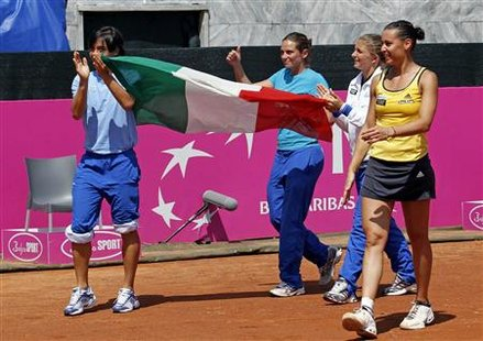 Italy's Francesca Schiavone (L) Roberta Vinci (2nd L), Sara Errani and Flavia Pennetta (R) celebrate after winning their Fed Cup World Group semi-final tennis match against Czech Republic in Rome, April 25, 2010. REUTERS/Giampiero Sposito
