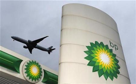An aircraft flies over a British Petroleum petrol station at Heathrow in London February 2, 2010. REUTERS/Toby Melville