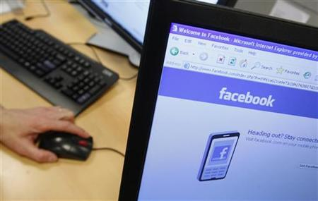 A Facebook page is displayed on a computer screen. REUTERS/Thierry Roge
