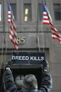 A man holds up a sign outside Goldman Sachs headquarters building in the financial district of New York January 21, 2010. REUTERS/Jessica Rinaldi