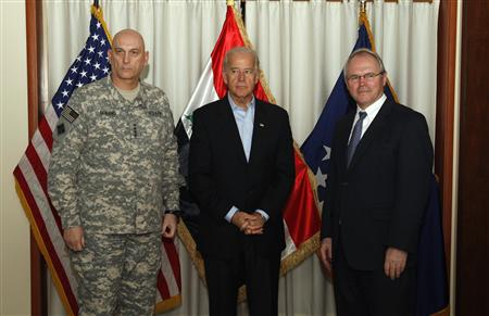 Vice President Joe Biden (C) poses for the media with top U.S. military commander in Iraq General Raymond Odierno (L) and U.S. Ambassador Chris Hill at the U.S. Embassy in Baghdad January 22, 2010. REUTERS/Thaier Al-Sudani