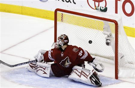 Phoenix Coyotes' goalie Ilya Bryzgalov fails to stop Detroit Red Wings' Pavel Datsyuk's second goal in the second period during Game 7 of their NHL Western Conference quarter-final hockey game in Glendale, Arizona April 27, 2010. REUTERS/Joshua Lott