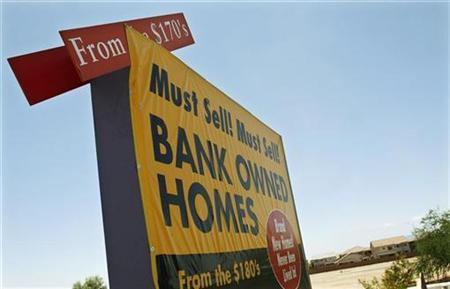 A sign offering bank owned homes for sale is seen in a subdivision in Maricopa, Arizona in this file REUTERS/Joshua Lott/Files