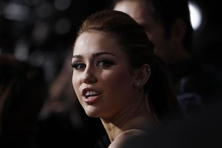"Cast member Miley Cyrus attends the premiere of ""The Last Song"" at the Arclight theatre in Hollywood, California March 25, 2010. The movie opens in the U.S. on March 31. REUTERS/Mario Anzuoni"