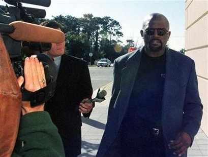 NFL Hall of Famer and former New York Giants football player Lawrence Taylor walks past the media on his way to court at the Pinellas County Criminal Justice Center in Cleawater, Florida on November 30, 1999 file photo. REUTERS/Str Old