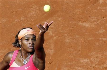 Serena Williams of the U.S. serves to Maria Kirilenko of Russia during their match at the Rome Masters tennis tournament May 6, 2010. REUTERS/Stefano Rellandini