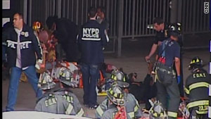Emergency personnel attend to people injured in Saturday's Staten Island Ferry crash in New York. (Courtesy of CNN).