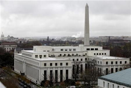 The Federal Reserve building is seen with the Washington Monument and U.S. Capitol in the background in Washington November 24, 2009. REUTERS/Yuri Gripas