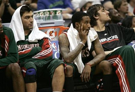 Milwaukee Bucks guard Carlos Delfino (L-R), Brandon Jennings and Andrew Bogut watch the final seconds in their loss to the Atlanta Hawks from the bench in Game 7 of their NBA Eastern Conference NBA basketball playoff series in Atlanta, Georgia, May 2, 2010. REUTERS/Tami Chappell