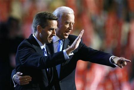 Attorney General Beau Biden (D-DE) (L) and Vice Presidential candidate Senator Joe Biden (D-DE) gesture on stage at the 2008 Democratic National Convention in Denver, Colorado August 27, 2008. REUTERS/Chris Wattie