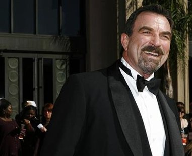 Actor Tom Selleck smiles as he arrives at the 58th annual Primetime Emmy Awards at the Shrine Auditorium in Los Angeles August 27, 2006. REUTERS/Mario Anzuoni
