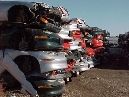 Piles of crushed GM EV1 electric cars By Plug In America [CC-BY-SA-2.0 (http://creativecommons.org/licenses/by-sa/2.0)], via Wikimedia Commons