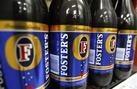 Bottles of Fosters beer are seen in a refrigerator at a liquor store in Melbourne in this February 16, 2010 file photo. REUTERS/Mick Tsikas