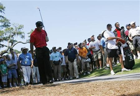 Tiger Woods of the U.S. reacts after his second shot on the seventh hole during final round play of the Tournament Players Championship PGA golf tournament at TPC Sawgrass in Ponte Vedra Beach, Florida in this May 9, 2010 file photo. REUTERS/Hans Deryk
