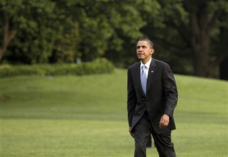 President Barack Obama walks on the South Lawn of the White House upon his return to Washington from Fremont, California May 26, 2010. REUTERS/Yuri Gripas
