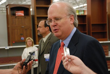 Karl Rove speaks to reporters at the Portage Meijer on Shaver Road