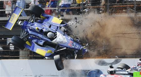 Dreyer & Reinbold Racing driver Mike Conway flies through the air after crashing with Andretti Autosport driver Ryan Hunter-Reay (R) during the 94th running of the Indianapolis 500 auto race in Indianapolis, Indiana May 30, 2010. REUTERS/Larry Papke
