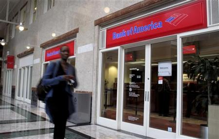 A woman walks past a Bank of America branch, inside the Bank of America headquarters in Charlotte, North Carolina April 14, 2010. REUTERS/Chris Keane