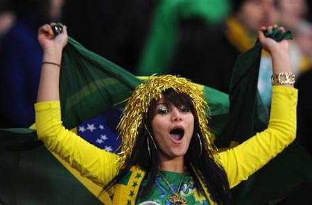 A Brazil fan sings during their international friendly soccer match against Ireland at Emirates Stadium in London March 2, 2010. REUTERS/Toby Melville