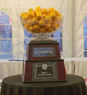 The trophy for the 2008 Orange Bowl, on display at the Orange Bowl Fanfest prior to the game. By Self (Own work) [Public domain], via Wikimedia Commons