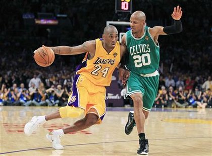 Los Angeles Lakers' Kobe Bryant (L) drives on Boston Celtics' Ray Allen during the fourth quarter of Game 7 of the 2010 NBA Finals basketball series in Los Angeles, California June 17, 2010 . REUTERS/Mike Blake