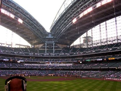 The inside of Miller Park from behind the outfield wall in center field.