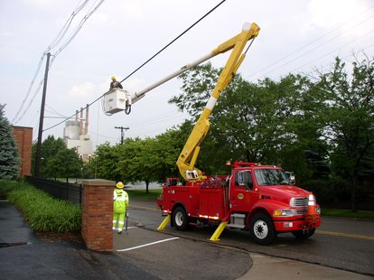 Holland BPW Crews work on repairing downed power lines.