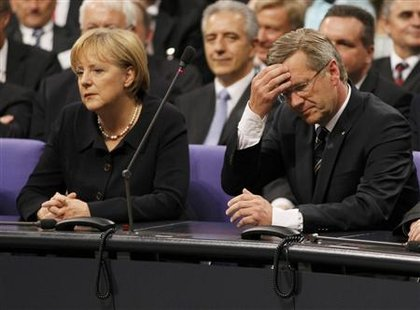 German Chancellor Angela Merkel and Christian Democratic Union party (CDU) candidate Lower Saxony state premier Christian Wulff (R) wait to hear the result of the German presidential election, at the Reichstag in Berlin June 30, 2010. REUTERS/Wolfgang Rattay