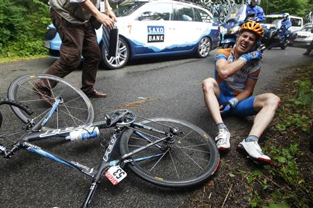 Garmin-Transitions' Tyler Farrar of the U.S sits on the road after a crash in the second stage of the Tour de France cycling race from Brussels to Spa, July 5, 2010. REUTERS/Bogdan Cristel