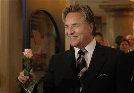 "Don Johnson arrives with a rose for a musical premiere of ""Miami Nights"" in Munich November 7, 2007. REUTERS/Michaela Rehle"