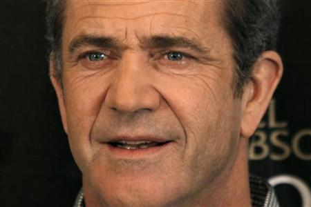 "Actor Mel Gibson poses during a photocall for the film ""Edge of Darkness"" by director Martin Campbell in Paris, February 4, 2010. REUTERS/Charles Platiau"