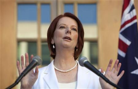 Australia's Prime Minister Julia Gillard talks at a news conference in Canberra July 17, 2010. Gillard called an early federal election to be held on August 21, with the poll to be fought over policies on economic management, climate and border protection. REUTERS/Andrew Taylor