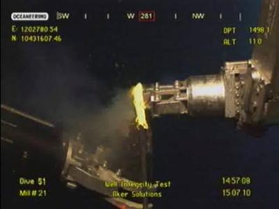 A robotic arm (L) is visible at work next to BP's new cap on the blown-out well in this image captured from a BP live video feed as BP launches a critical pressure test on its ruptured Gulf of Mexico oil well on July 15, 2010.